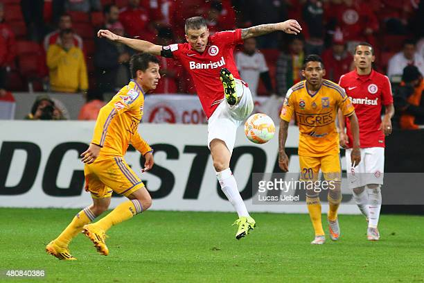 Andres Dalessandro of Internacional battles for the ball against Jurgen Damm of Tigres during the match between Internacional v Tigres as part of...