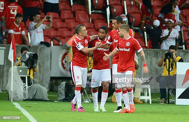 Andres D´Alessandro of Internacional celebrates with teammates after scoring the first goal of his team during a match between Internacional and U de...