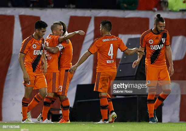 Andres D'Alessandro of River Plate celebrates with teammates after scoring the third goal of his team during a match between River Plate and Banfield...