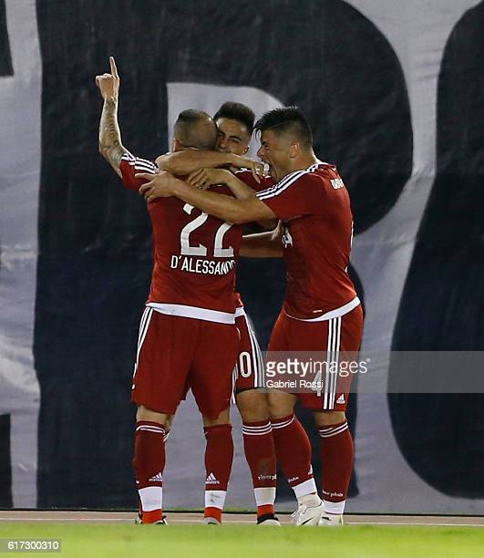 Andres D´alessandro of River Plate celebrates with teammates after scoring the first goal of his team during a match between River Plate and Atletico...