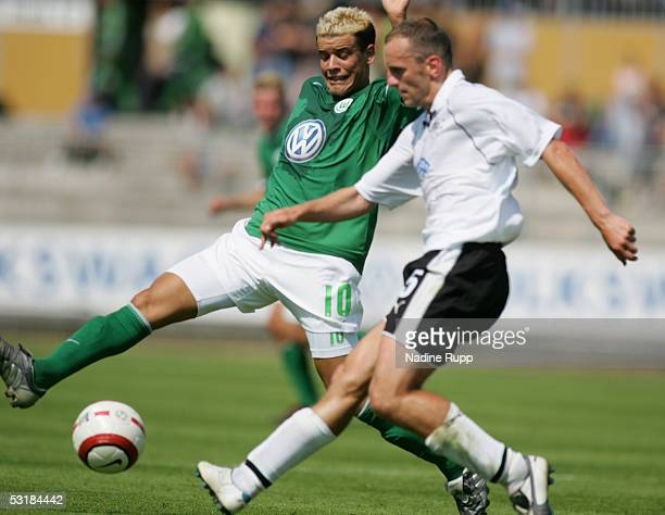 Andres DAlessandro of Wolfsburg competes with Adam Ledwon of Graz during the UI Cup match between VfL Wolfsburg and Sturm Graz on July 2 2005 in...