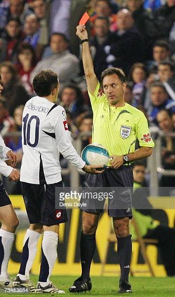 Andres D'Alessandro of Zaragoza is shown the red card by referee Luis Medina during the Kings Cup quarter-final 2nd leg match between Real Zaragoza...