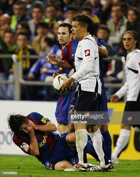 Andres D'Alessandro of Zaragoza knocks over Lionel Messi of Barcelona during the Kings Cup quarterfinal 2nd leg match between Real Zaragoza and...