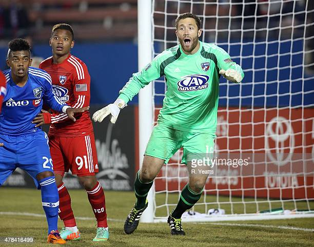 Andres Escobar defends Santiago Gonzalez of Montreal Impact as Chris Seitz of FC Dallas reacts to the play at Toyota Stadium on March 8 2014 in...