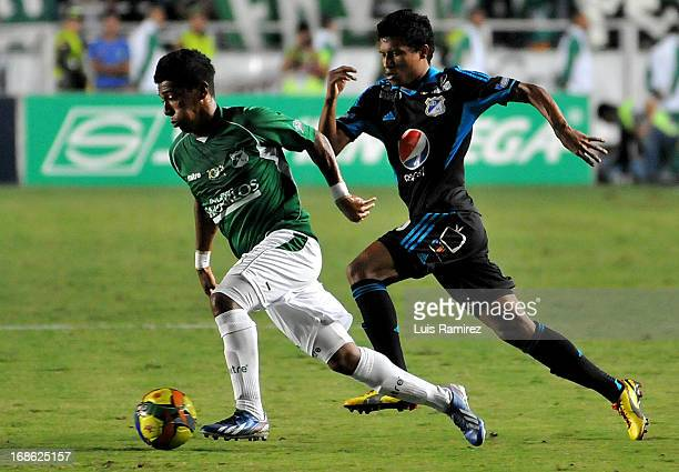 Andres Escobar of Deportivo Cali fights for the ball with Johnny Ramirez of Millonarios during a match between Deportivo Cali and Millonarios as part...