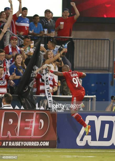 Andres Escobar of FC Dallas celebrates after scoring a goal past Bobby Shuttleworth of New England Revolution at Toyota Stadium on July 19 2014 in...