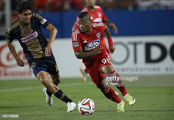 Andres Escobar of FC Dallas dribbles the ball upfield around Cristian Maidana of Philadelphia Union at Toyota Stadium on July 4 2014 in Frisco Texas