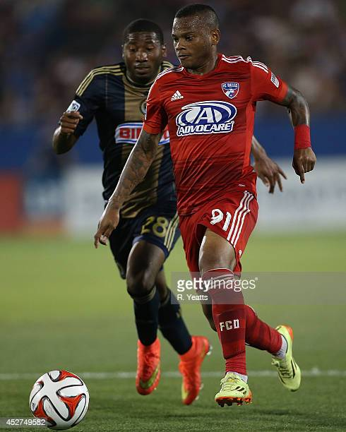 Andres Escobar of FC Dallas dribbles the ball upfield past Raymon Gaddis of Philadelphia Union at Toyota Stadium on July 4 2014 in Frisco Texas
