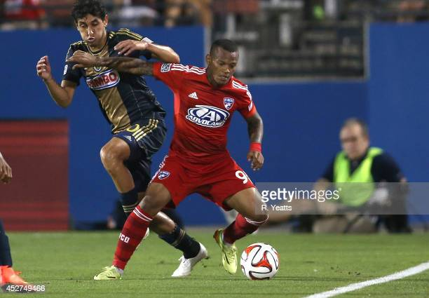 Andres Escobar of FC Dallas fights with Cristian Maidana to maintain control of the ball at Toyota Stadium on July 4 2014 in Frisco Texas