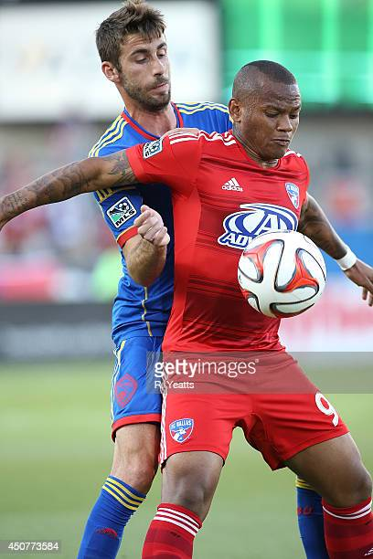 Andres Escobar of FC Dallas fights with Jose Mari of Colorado Rapids for position at Toyota Stadium on June 7 2014 in Frisco Texas