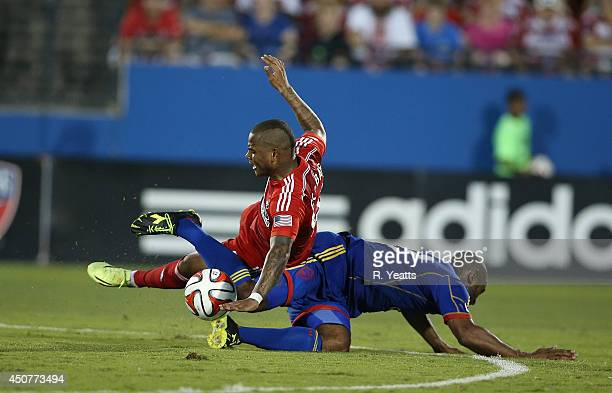 Andres Escobar of FC Dallas is tripped by Marvell Wynne at Toyota Stadium on June 7 2014 in Frisco Texas