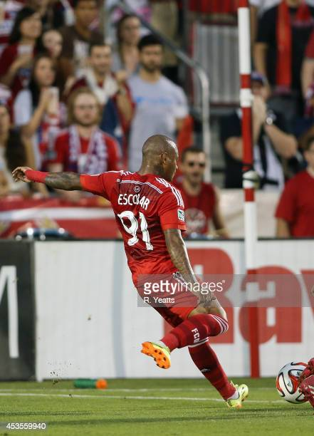 Andres Escobar of FC Dallas kicks the ball against the New England Revolution scoring a goal at Toyota Stadium on July 19 2014 in Frisco Texas