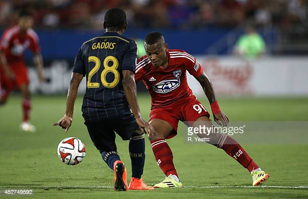 Andres Escobar of FC Dallas kicks the ball around Raymon Gaddis of Philadelphia Union at Toyota Stadium on July 4 2014 in Frisco Texas