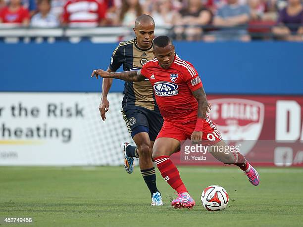 Andres Escobar of FC Dallas passes the ball upfield as Fabinho of Philadelphia Union pursues at Toyota Stadium on July 4 2014 in Frisco Texas