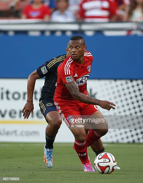 Andres Escobar of FC Dallas pushes the ball upfield as Fabinho of Philadelphia Union pursues at Toyota Stadium on July 4 2014 in Frisco Texas