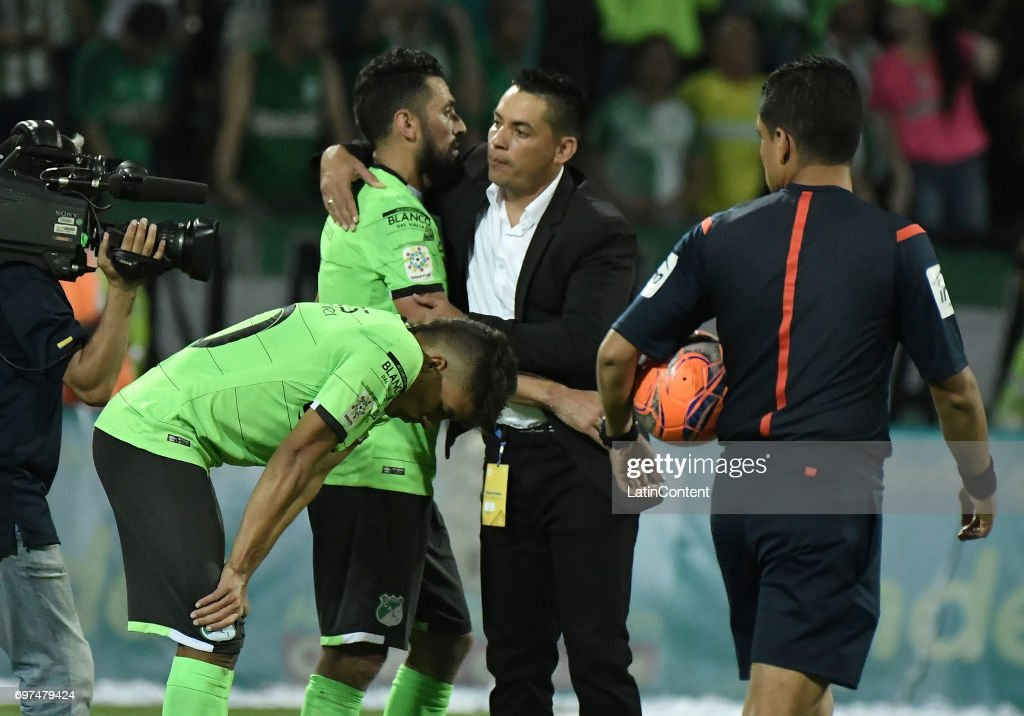 Andres Felipe Roa, Andres Perez and coach Hector Cardenas, of Deportivo Cali look dejected after the Final second leg match between Atletico Nacional and Deportivo Cali as part of Liga Aguila I 2017 at Atanasio Girardot Stadium on June 18, 2017 in Medellin, Colombia.