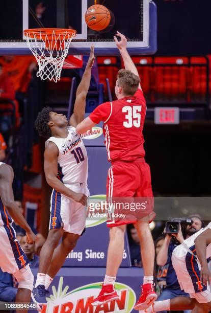 Andres Feliz of the Illinois Fighting Illini defends against the shot of Nate Reuvers of the Wisconsin Badgers at State Farm Center on January 23...