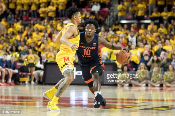 Andres Feliz of the Illinois Fighting Illini dribbles the ball against Anthony Cowan Jr #1 of the Maryland Terrapins during the first half at Xfinity...