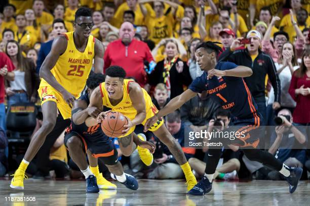 Andres Feliz of the Illinois Fighting Illini fouls Anthony Cowan Jr #1 of the Maryland Terrapins during the second half at Xfinity Center on December...