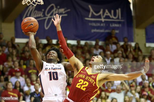 Andres Feliz of the Illinois Fighting Illini takes a shot under the basket as he is defended by Tyrese Hailburton of the Iowa State Cyclones during...