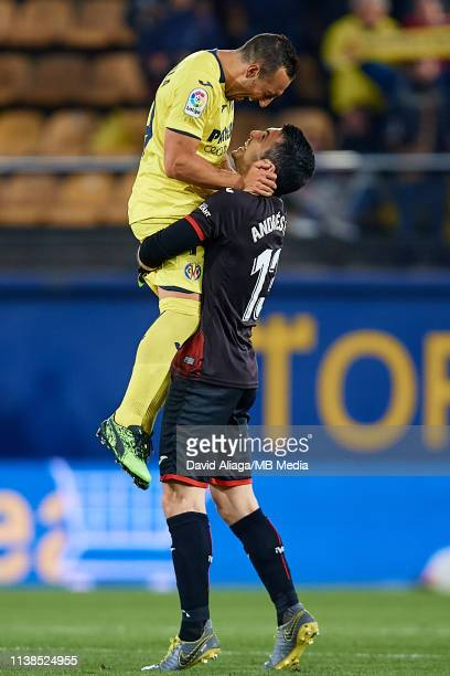Andres Fernandez of Villarreal CF celebrates the victory with his teammate Santi Cazorla during the La Liga match between Villarreal CF and CD...