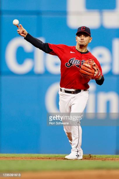 Andres Gimenez of the Cleveland Indians throws out Sebastian Rivero of the Kansas City Royals at first base in the seventh inning during game two of...