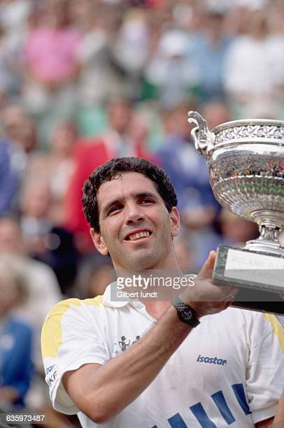 Andres Gomez lifts the winner's trophy at the 1990 French Open