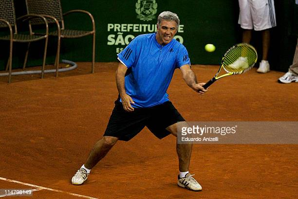 Andres Gomez of Ecuador in action against Yevgeny Kafaelnikov of Russia during the ATP Grand Champions Brazil at Sociedade Harmonica de Tenis on May...