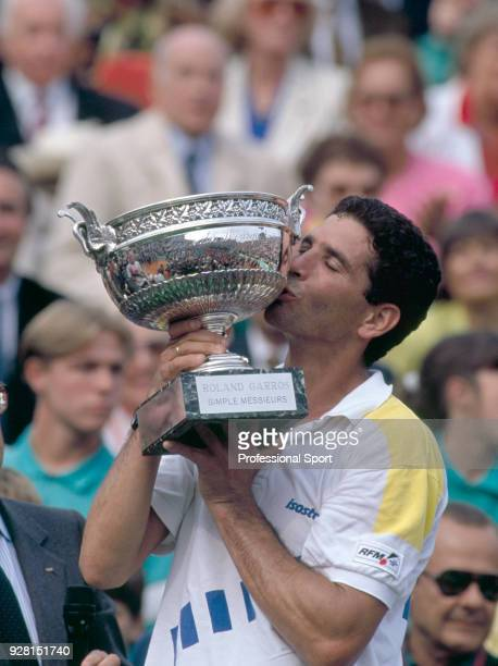 Andres Gomez of Ecuador kissing the trophy after defeating Andre Agassi of the USA in the Men's Singles Final of the French Open Tennis Championships...