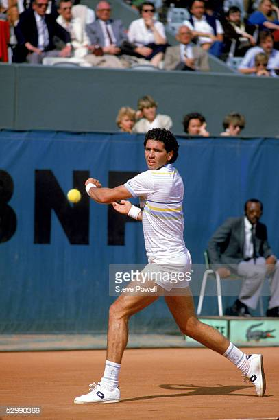 Andres Gomez of Ecuador prepares to return the ball on a backhand during a match in the 1984 French Open at Roland Garros in Paris France