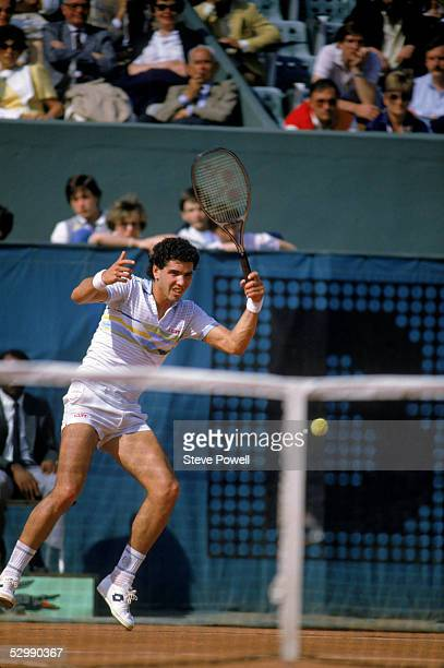 Andres Gomez of Ecuador returns the ball during a match in the 1984 French Open at Roland Garros in Paris France