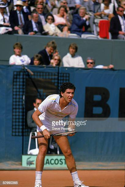 Andres Gomez of Ecuador waits for play during a match in the 1984 French Open at Roland Garros in Paris France