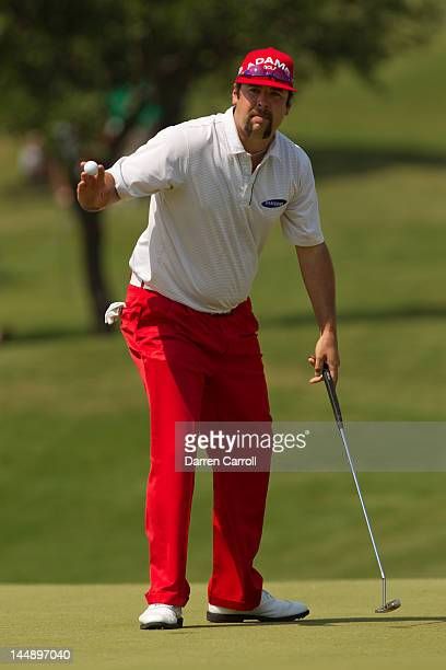 Andres Gonzales of the United States acknowledges the gallery at the first hole during the final round of the HP Byron Nelson Championship at TPC...