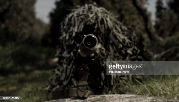 Andres Gonzalez from spanish airsoft team Condenados sees his target through the telescopic sights of his rifle during a simulation of combat in a...