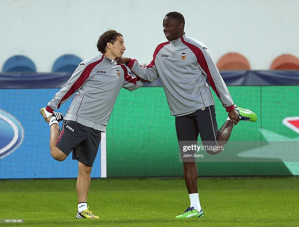 Andres Guardado and Aly Cissokho (R) of Valencia warm up during a training session on the eve of the Champions League match between Paris Saint Germain FC and Valencia CF at the Parc des Princes stadium on March 5, 2013 in Paris, France.