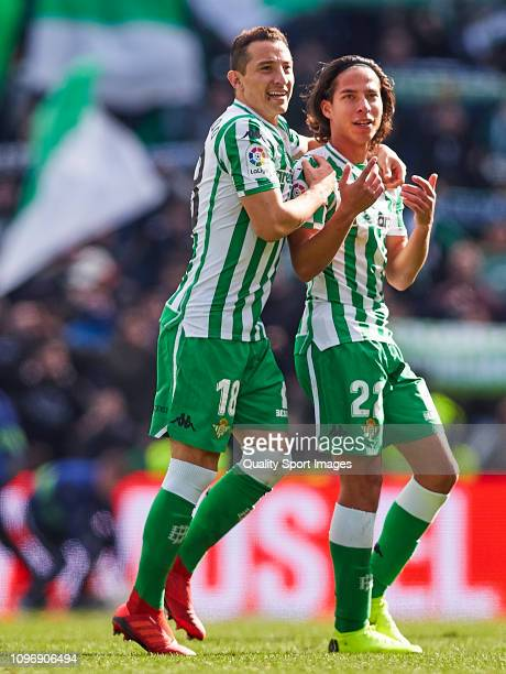 Andres Guardado and Diego Lainez of Real Betis celebrate the victory during the La Liga match between Real Betis Balompie and Girona FC at Estadio...