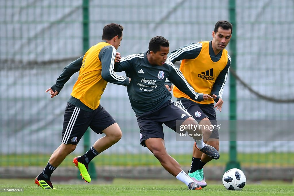 Andres Guardado, Giovani dos Santos and Rafael Marquez of Mexico, struggles for the ball the ball during a training session at team training base Novogorsk-Dynamo on June 14, 2018 in Moscow, Russia.