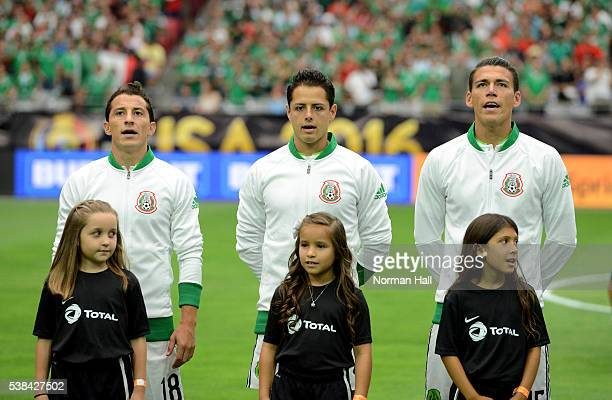 Andres Guardado Javier Chicharito Hernandez and Hector Moreno of Mexico sing the national anthem prior to a group C match against Uruguay at...