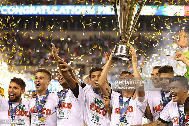 Andres Guardado of Mexico and teammates celebrate after defeating Jamaica in the CONCACAF Gold Cup Final at Lincoln Financial Field on July 26, 2015...