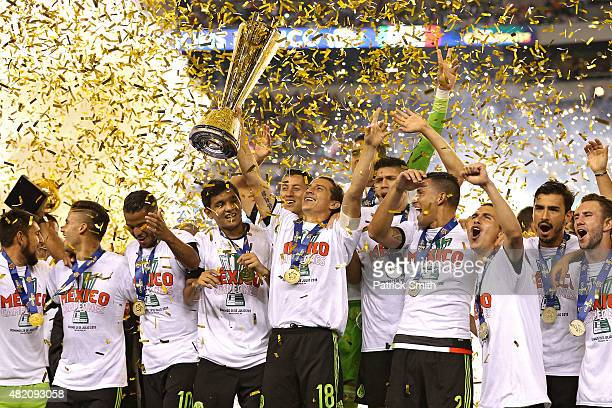 Andres Guardado of Mexico and teammates celebrate after defeating Jamaica in the CONCACAF Gold Cup Final at Lincoln Financial Field on July 26 2015...