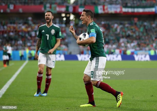 Andres Guardado of Mexico appeals to assistant referee for a decision during the 2018 FIFA World Cup Russia group F match between Mexico and Sweden...