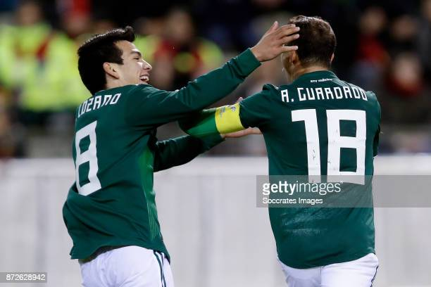 Andres Guardado of Mexico celebrates 11 with Hirving Lozano of Mexico during the International Friendly match between Belgium v Mexico at the Koning...