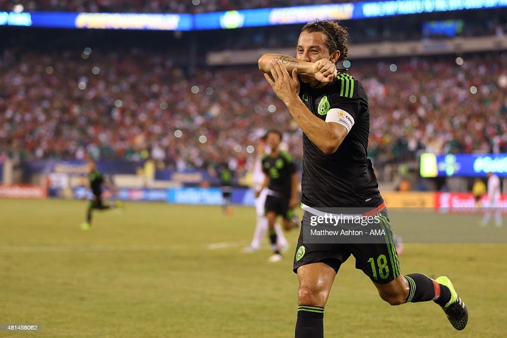 Andres Guardado of Mexico celebrates after scoring a goal to make it 1-0 in the last minute of the game from a controversial penalty kick during the Gold Cup Quarter Final between Mexico and Costa Rica at MetLife Stadium on July 19, 2015 in East Rutherford, New Jersey.