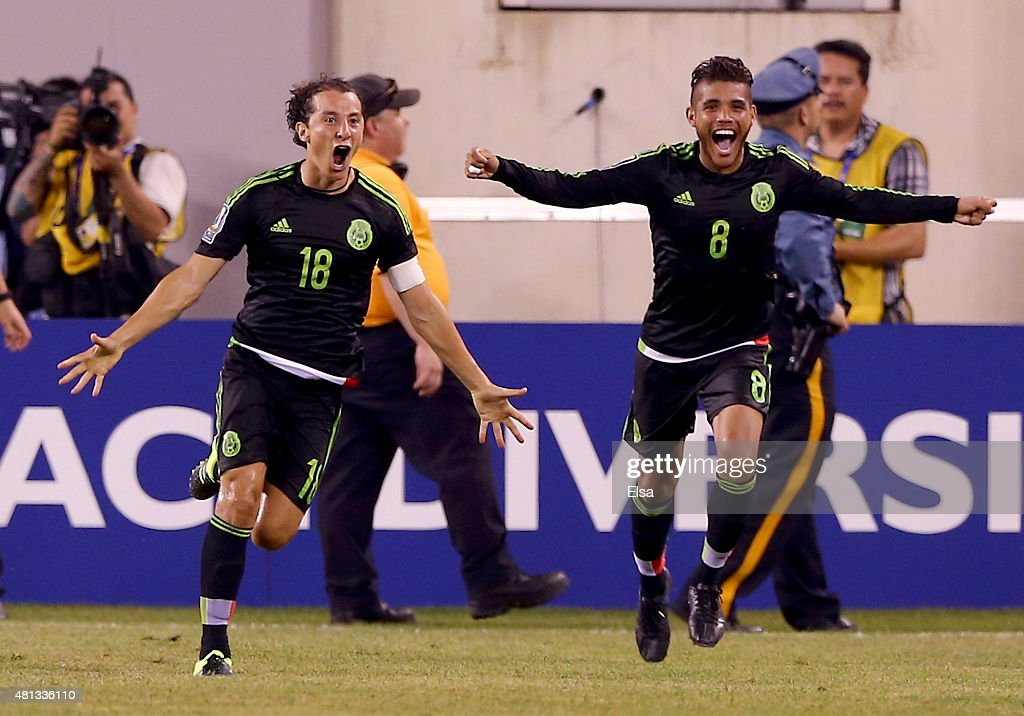 Andres Guardado #18 of Mexico celebrates his goal with teammate Jonathan do Santos #8 in the final minute of overtime against Costa Rica during the quarterfinals of the 2015 CONCACAF Gold Cup at MetLife Stadium on July 19, 2015 in East Rutherford, New Jersey.