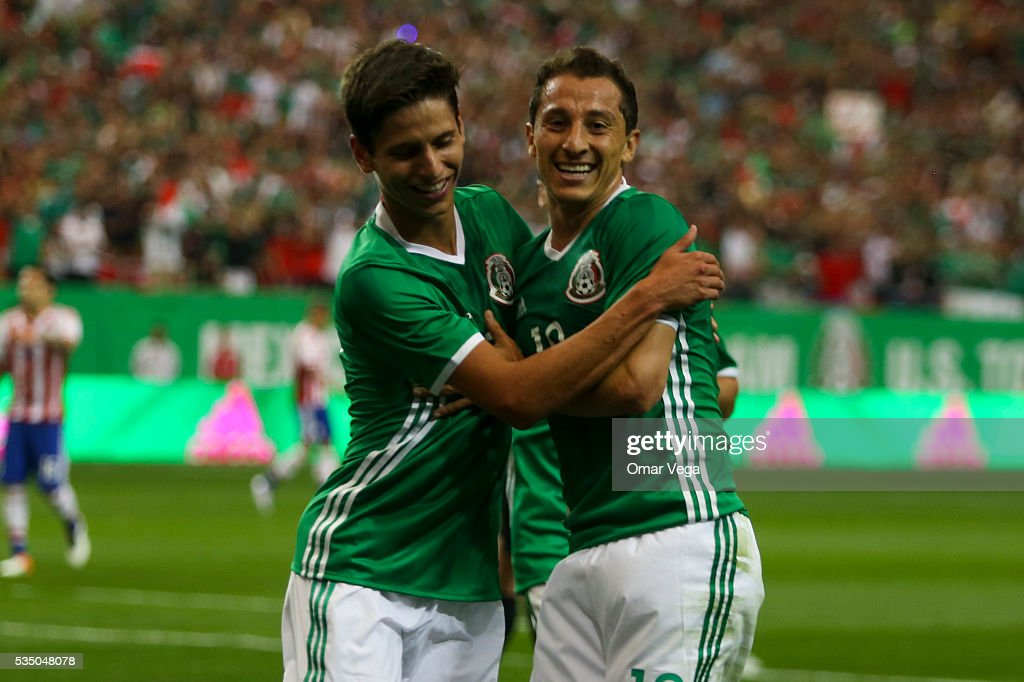 Andres Guardado of Mexico celebrates with his teammate after scoring the first goal of his team during the International Friendly between Mexico and Paraguay at Georgia Dome on May 28, 2016 in Atlanta, Georgia.