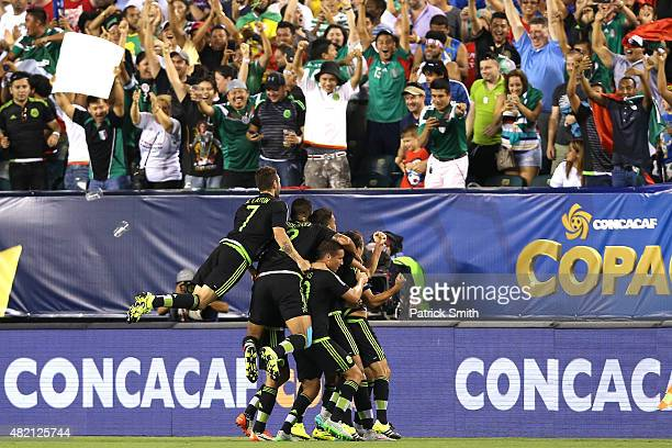 Andres Guardado of Mexico celebrates with teammates after scoring in the first half against Jamaica during the CONCACAF Gold Cup Final at Lincoln...