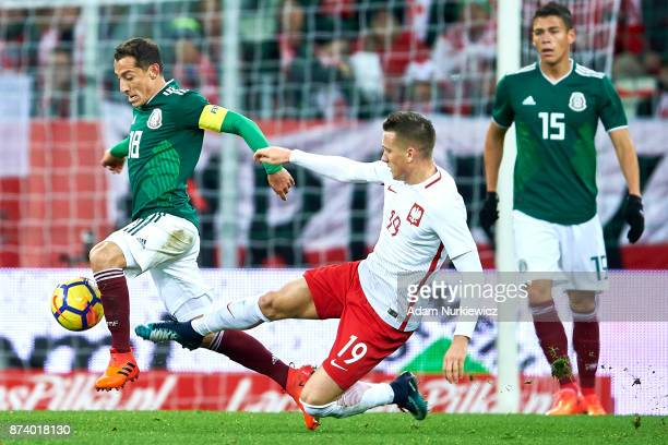 Andres Guardado of Mexico fights for the ball with Piotr Zielinski of Poland during the International Friendly match between Poland and Mexico at...