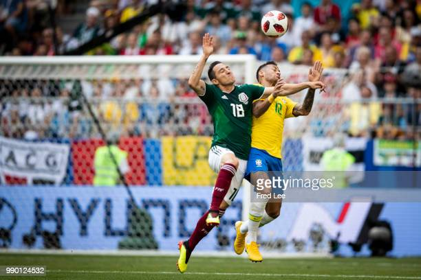 Andres Guardado of Mexico goes for a header with Neymar of Brazil during the 2018 FIFA World Cup Russia Round of 16 match between Brazil and Mexico...