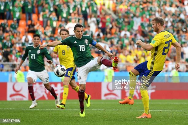 Andres Guardado of Mexico is challenged by Ola Toivonen of Sweden during the 2018 FIFA World Cup Russia group F match between Mexico and Sweden at...