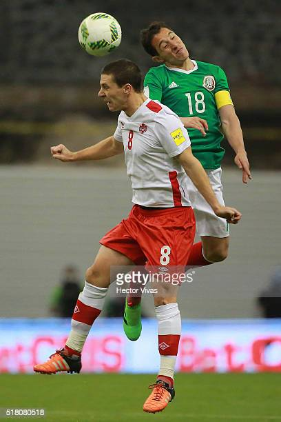 Andres Guardado of Mexico jumps for the ball with Will Johnson of Canada during the match between Mexico and Canada as part of the FIFA 2018 World...